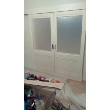 Параллельно-сдвижная двухстворчатая дверь